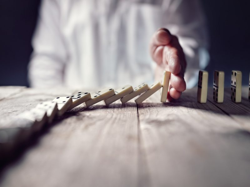 Stop the domino effect concept for business solution and interve